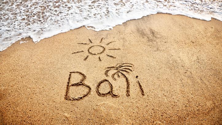 Bali écriture sable mer